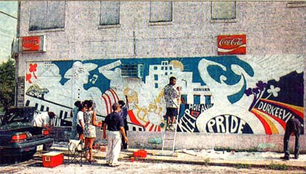 photo of Wynn and youths painting a mural